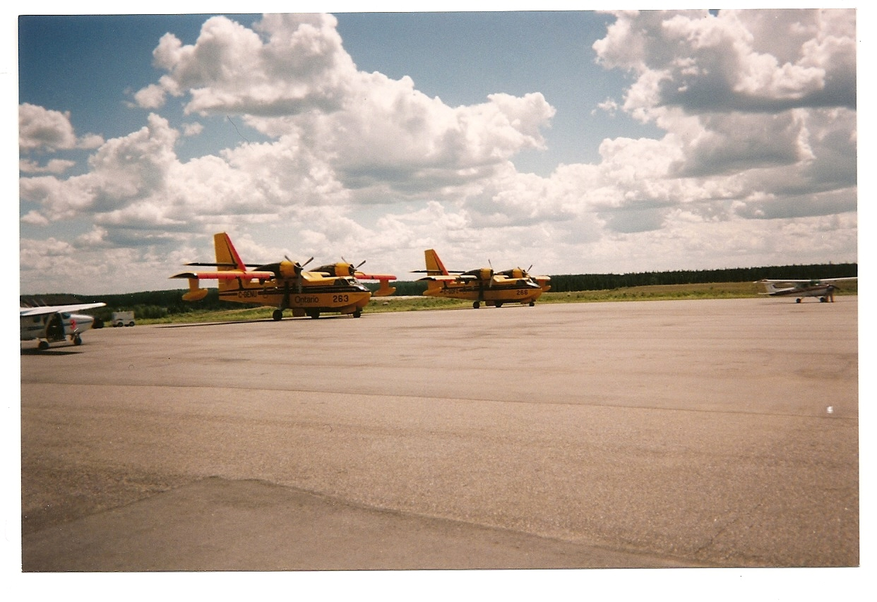 Two CL-415's waiting on the tarmac