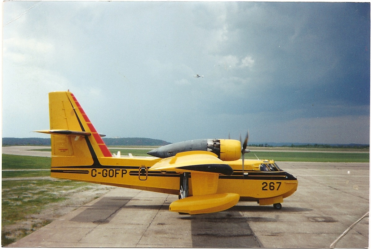 Waterbomber on the Tarmac with a lightweight spotter plane in the background